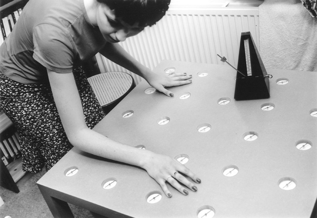 Photograph of woman with Dunne & Raby's 'Compass Table'